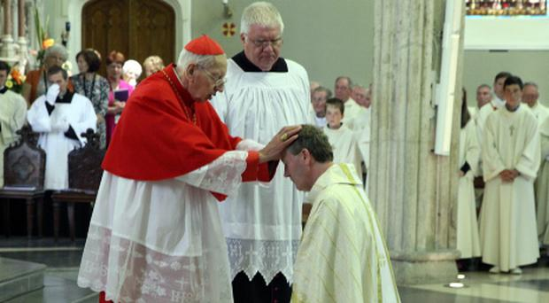 Archbishop Emeritus of Dublin Desmond Connell, lays his hands on the head of newly ordained Bishop Denis Nulty in the Church of the Assumption, Carlow Cathedral