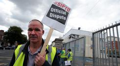Pat Byrne picketing at Ringsend bus depot in Dublin. Photo: Arthur Carron/Collins