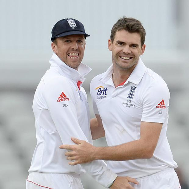 England's James Anderson (right) celebrates with Graeme Swann after taking the wicket of Australia's Brad Haddin, during day four of the Third Ashes test match at Old Trafford Cricket Ground, Manchester. Picture: Martin Rickett/PA Wire.