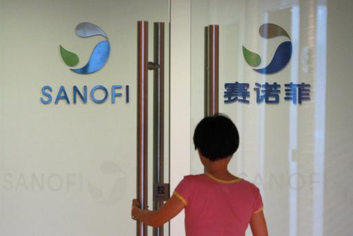 An employee walks into an office of French drugmaker Sanofi in Shanghai