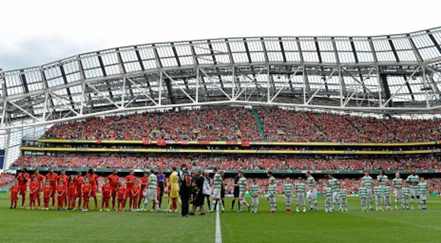 Players from Liverpool and Celtic teams shake hands before the game at the Aviva in August