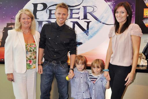 Nicky Byrne and wife Georgina Ahern-Byrne pose with their twin sons Rocco and Jay and Georgina's mother, Miriam Ahern