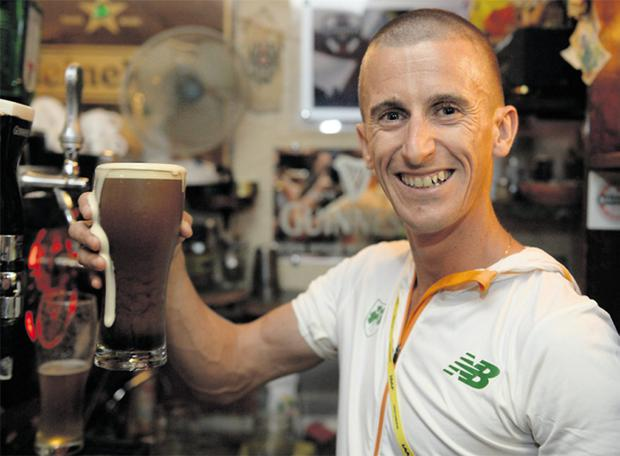 Robert Heffernan with a pint of Guinness at Silver's Irish Pub in Red Square