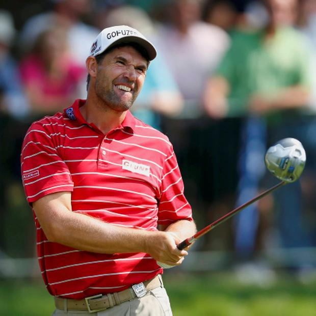 Ireland's Padraig Harrington watches his shot on the 14th hole during a practice round for the 2013 PGA Championship golf tournament at Oak Hill Country Club in Rochester. Picture: Reuters/Jeff Haynes.
