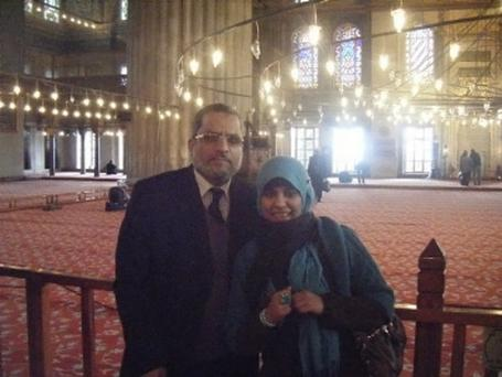 Omaima 21 who is a mosque in Cairo Egypt. Pictured is Omaima with her father the Imam Hussein Halawa Collect from Halawa Family