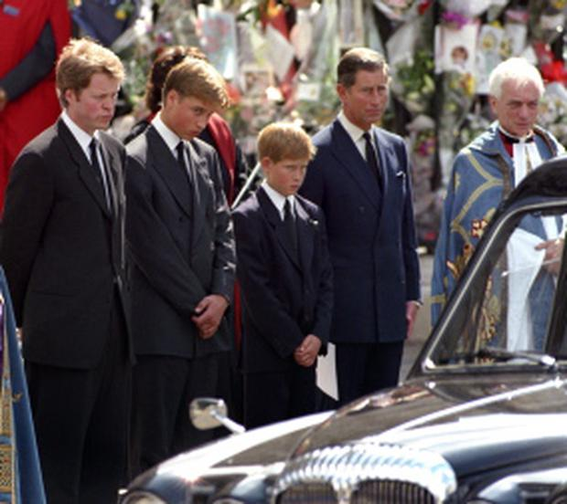The Earl Spencer, Prince William, Prince Harry and The Prince of Wales waiting as the hearse carrying the coffin of Diana, Princess of Wales prepares to leave Westminster Abbey following her funeral service in September 1997. Fiona Hanson/PA Wire