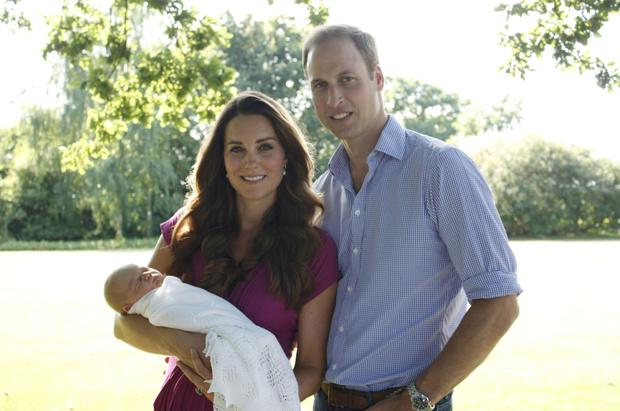 Handout photo taken by Michael Middleton, the Duchess's father in early August and supplied by Kensington Palace of the Duke and Duchess of Cambridge as they stand with their son, Prince George in the garden of the Middleton family home in Bucklebury, Berkshire.