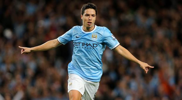 Manchester City's Samir Nasri celebrates scoring his side's fourth goal during the Barclays Premier League match at the Etihad Stadium, Manchester.