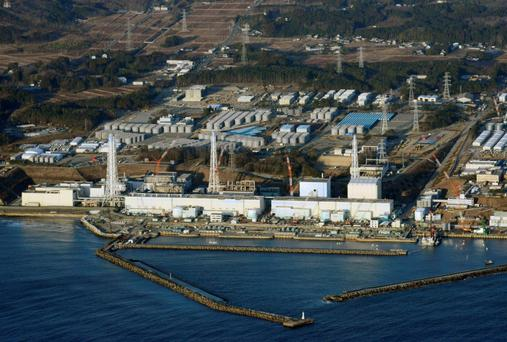 An aerial view shows Tokyo Electric Power Co.'s (TEPCO) tsunami-crippled Fukushima Daiichi nuclear power plant in Fukushima