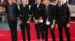 LONDON, ENGLAND - AUGUST 20: (L-R) One Direction members Harry Styles, Niall Horan, Louis Tomlinson, Zayn Malik and Liam Payne attend the World Premiere of 'One Direction: This Is Us' at Empire Leicester Square on August 20, 2013 in London, England. (Photo by Tim P. Whitby/Getty Images)