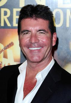 Simon Cowell arriving for the World Premiere of One Direction