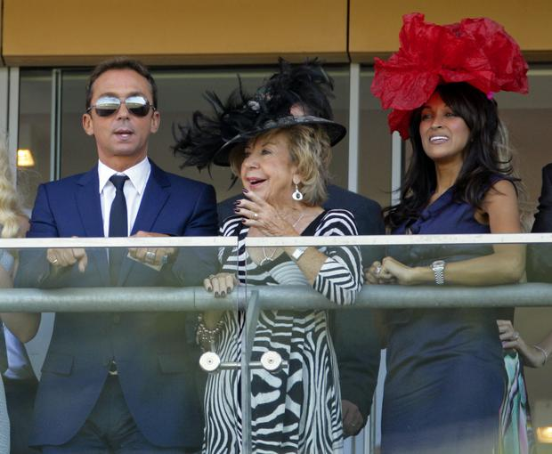 Julie Cowell (Simon Cowell's mother) and his ex Jackie St Clair watch the racing at Ascot in 2010.