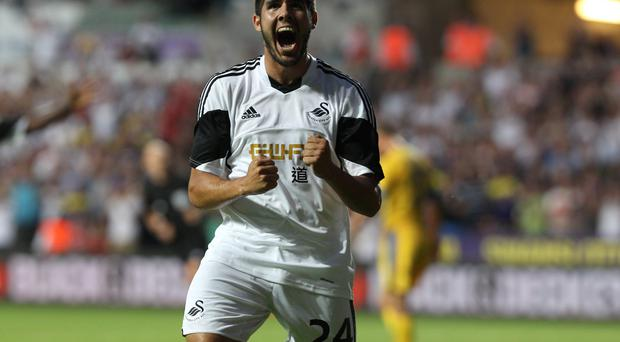 Swansea City's Ajejandro Pozuelo celebrates the fifth goal during the UEFA Europa League Qualifying Play-Off, First Leg at the Liberty Stadium, Swansea.