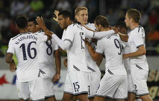 Tottenham's players celebrate after scoring against Dinamo Tbilisi during their Europa League playoff first leg soccer match in Tbilisi, Georgia