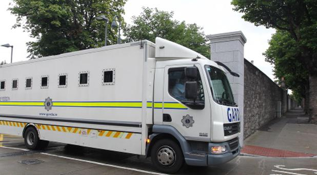 21/8/2013; David Gill leaves the Criminal courts of Justice in the back of a Garda Van. Picture credit; Damien Eagers / Irish Independent