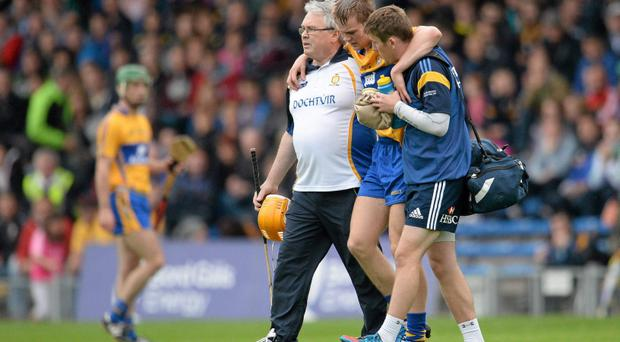 Aaron Cunningham, Clare, is assisted from the field with a hamstring injury in the semi-final