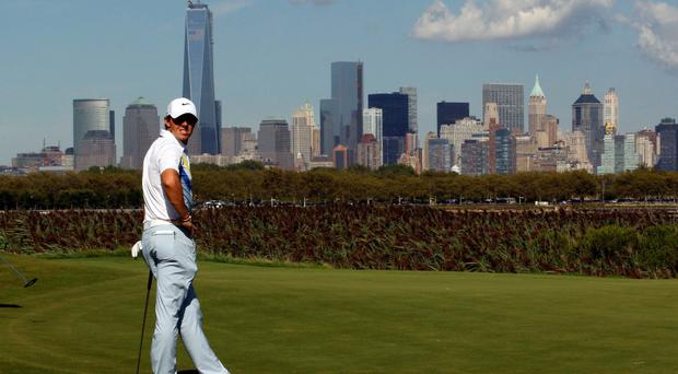 Northern Ireland's Rory McIlroy stands in front of the New York skyline
