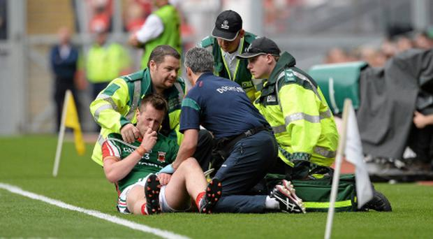 Cillian O'Connor receives attention after a first half shoulder injury - it will be difficult for him to recover in time for the All-Ireland football final