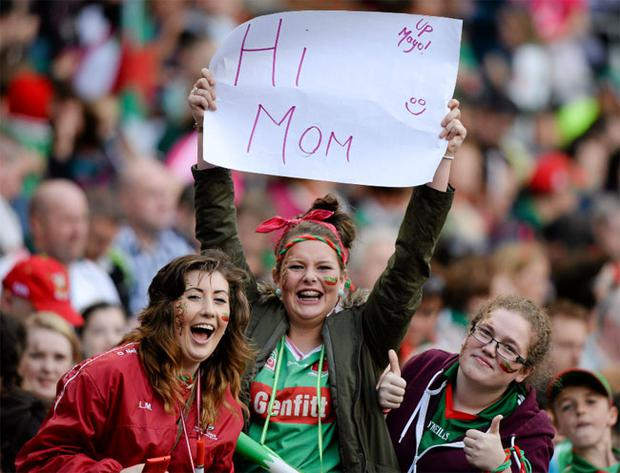 Mayo supporters Nuala Connolly, centre, from Kilmaine, and her friends Laura Muldoon, from Mulranny, and Hanna Callaghan, from Achil, send good wishes to their mother's in the Davin stand of Croke Park.