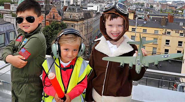 Leon Tully as Maverick from Top Gun, Arona Romeri and Robert Kennedy with a model B17 Flying Fortress as FlightFest announces list of aircraft and partners with Temple Street Childrens Hospital and ORBIS