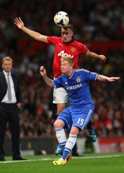 Phil Jones of Manchester United competes with Kevin De Bruyne of Chelsea during the Barclays Premier League match between Manchester United and Chelsea at Old Trafford