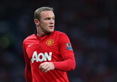 Wayne Rooney of Manchester United looks on during the Barclays Premier League match between Manchester United and Chelsea at Old Trafford on August 26, 2013 in Manchester, England