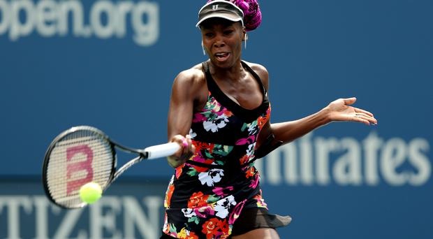 Venus Williams of the United States of America plays a forehand during her women's singles first round match against Kirsten Flipkens of Belgium first round match on Day One of the 2013 US Open