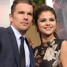 Actors Ethan Hawke (L) and Selena Gomez arrive at the premiere of Warner Bros. Pictures'