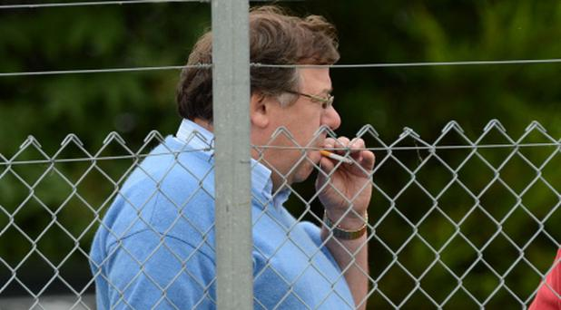 Former Taoiseach Brian Cowen watches an Offaly v Dublin camogie match in Kildare at the weekend