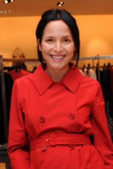 Andrea Corr stepped out in a stylish red trench coat during her pregnancy.
