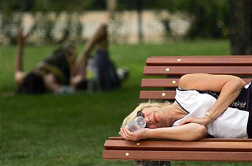 A woman takes a 'siesta' in Madrid
