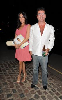 LONDON, UNITED KINGDOM - AUGUST 28: Lauren Silverman and Simon Cowell sighting in Kensington on August 28, 2013 in London, England. (Photo by Alan Chapman/FilmMagic)