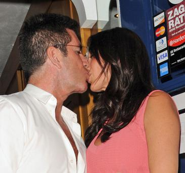 LONDON, UNITED KINGDOM - AUGUST 28: Simon Cowell and Lauren Silverman sighting at Scalini Restaurant, Chelsea on August 28, 2013 in London, England. (Photo by Alan Chapman/FilmMagic)