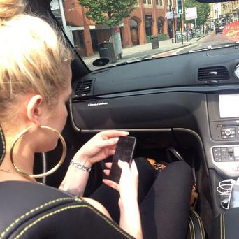 The reality TV star also shared a photo of herself in the sports car. (Photo: Twitter/ Helen Flanagan)