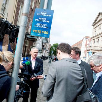 Minister Richard Bruton addresses the media at the launch of the first Fine Gael Seanad referendum poster on molesworth street in Dublin. Photo: El Keegan