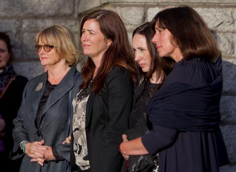 Seamus Heaney's wife Marie stands with their daughter as they wait to go into the Church of the Scared Heart, Donnybrook, Dublin, for the requiem mass before the poet's funeral tomorrow. PRESS ASSOCIATION Photo.