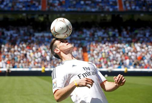 Gareth Bale of Wales heads a ball at the Santiago Bernabeu stadium in Madrid, September 2, 2013