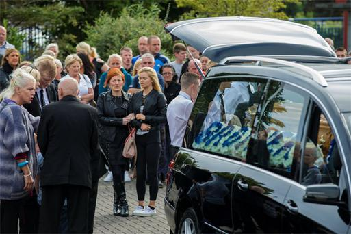 Mourners at the funeral of Dean Johnson