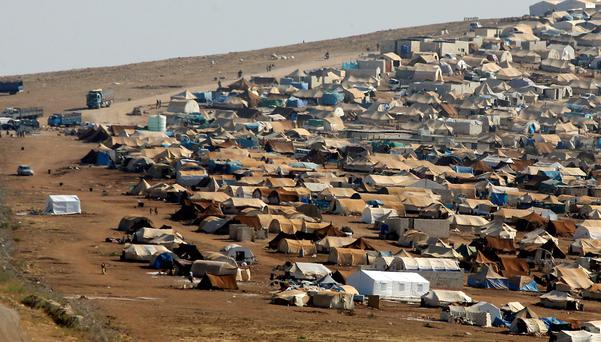 A refugee camp is seen in the Syrian territory near the Turkish border town of Cilvegozu