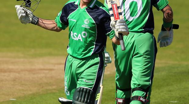 William Porterfield of Ireland celebrates his century during the RSA Challenge One Day International match between Ireland and England in Malahide, Ireland. (Photo by Clive Rose/Getty Images)