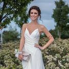 Grace teamed the Grecian-style dress with an off-white satin clutch, gold braid-detailed shoes and a gold arm-cuff. Photo: Pat Moore
