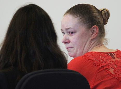 Aisling Brady McCarthy, right, from Quincy, Mass., sits with her attorney Melinda Thompson