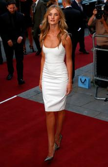 Model Rosie Huntington-Whiteley arrives for the GQ Men of the Year awards