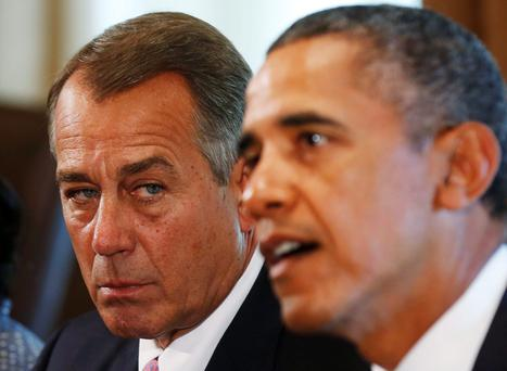 Speaker of the House John Boehner (R-OH) (L) listens to U.S. President Barack Obama during a meeting with bipartisan Congressional leaders in the Cabinet Room at the White House