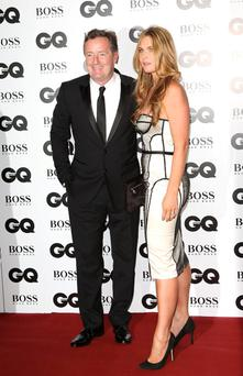 LONDON, ENGLAND - SEPTEMBER 03: Piers Morgan and guest attend the GQ Men of the Year awards at The Royal Opera House on September 3, 2013 in London, England. (Photo by Tim P. Whitby/Getty Images)