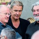 Christy Moore, Johnny Logan and Pat Henry at the funeral of Ticketmaster boss Eamon O'Connor