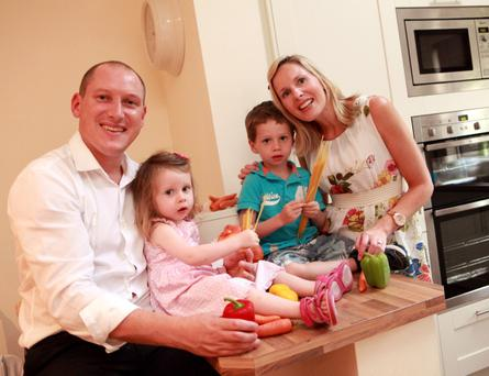 KITCHEN CAPERS: Ross and Laura Haugh, withchildren James and Lucy