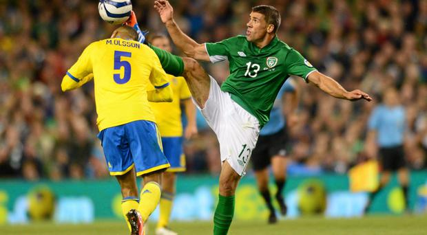 Jonathan Walters, Republic of Ireland, in action against Martin Olsson, Sweden on Friday