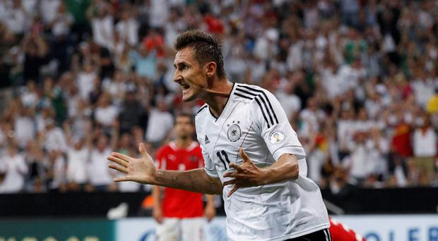 Germany's Miroslav Klose celebrates after scoring tonight