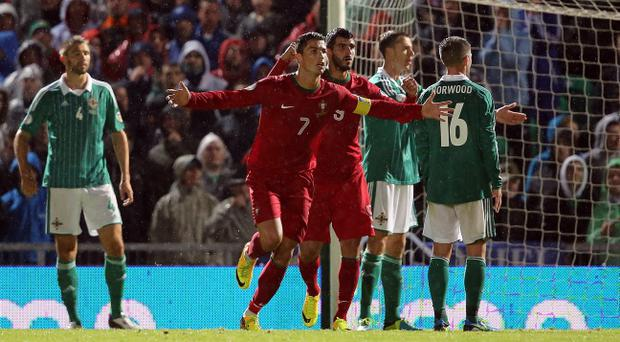Portugal's Cristiano Ronaldo celebrates scoring his second goal against Northern Ireland tonight